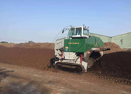 Windrow composting machine working for dewatered cow dung processing